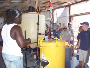 Converting used vegetable oil into bio-diesel to power vehicles on the island . . .